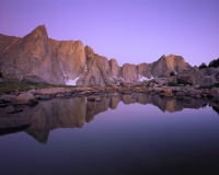 Peaks tower in a small pond overlooking a remote alpine valley.  Wind River Range, Wyoming - August 2017Velvia 50 4x5, 75mm lens90 seconds at f32, 1 stop soft GND filter